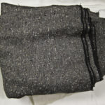The tweed for the mink-lined coat - grey herringbone with black, white & taupe flecks