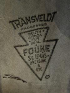 """fur seal"" stamp on skin side of fur coat used for lining"